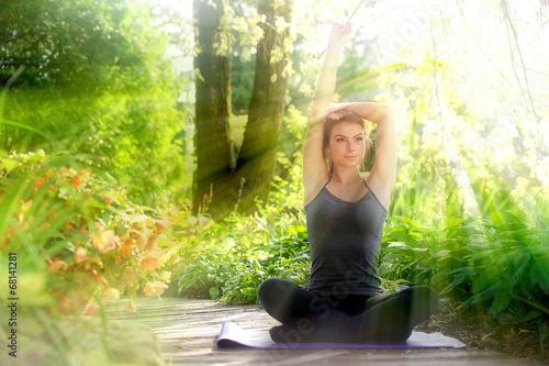 Young woman doing yoga - 68141281