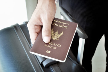 Hand holding passport