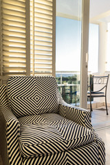 stripey chair in bedroom
