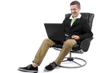 adult male working from home in a relaxing chair