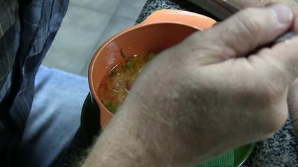 man eats the Ukrainian borsch ( soup). Time lapse