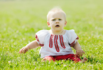 baby in traditional folk clothes