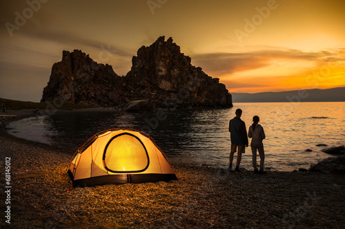Camping at lake and beautiful sunset - 68145012