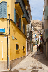 Narrow street in old district. Alicante