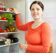 woman  near refrigerator at domestic kitchen