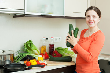 positive woman cooking with squash