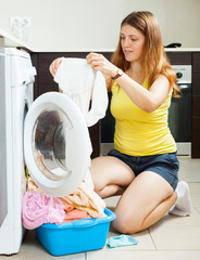 woman with white clothes near washing machine
