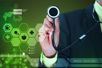 Young doctor showing stethoscope