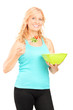 Vertical shot of a mature lady eating a salad