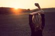 Young woman enjoys sun beams