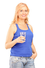 Mature woman holding a glass of water