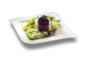 rocket salad and cheese with blueberry sauce