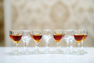 Glasses of brandy arranged in a row