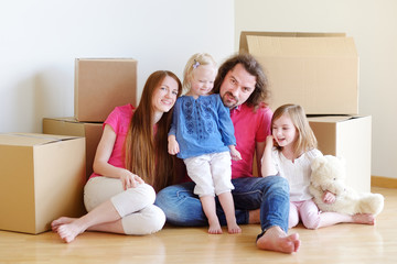 Happy young family in their new home