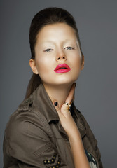 Elegance. Asian Woman with Trendy Makeup