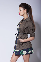 Stylishness. Fashionable Woman posing in Elegant Coat