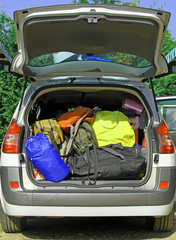 car full of luggage and suitcases for the summer holidays