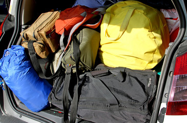 suitcases and travel bags in the trunk of the car