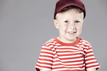 Portrait of a four year old boy with a hat