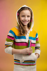 cute little girl holding pencils.