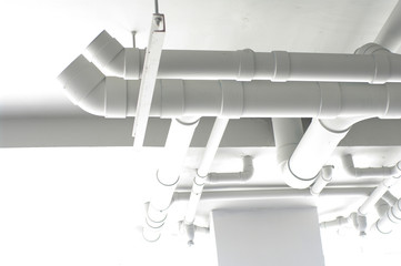 white pipes on the ceiling