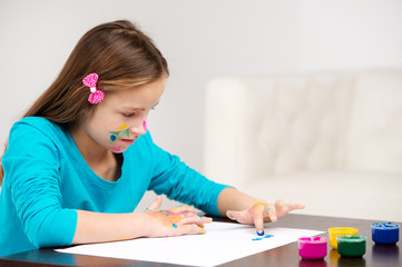 little girl drawing pictures with finger.