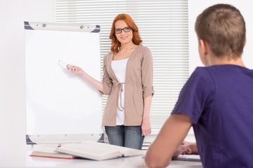 young attractive tutor girl teaching.
