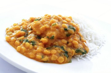 Indian tarka dhal lentil curry on plate with rice