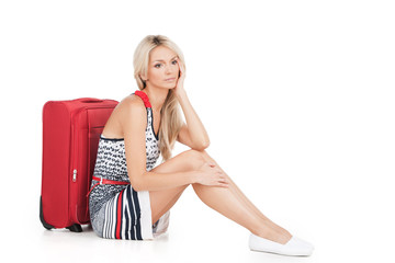 beautiful girl sitting on floor with luggage.