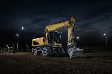 Road construction, close up of excavator at night