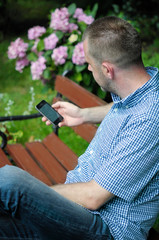 Man Looking at Smartphone