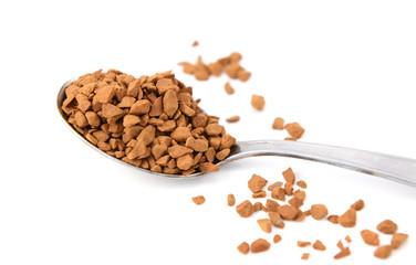 Closeup of a teaspoon of instant coffee granules