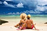 Fototapety Couple on a beach at Seychelles