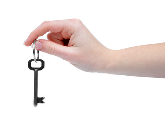 Hand and key isolated on white background