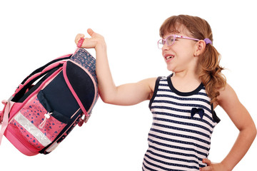 little girl trying to lift heavy schoolbag