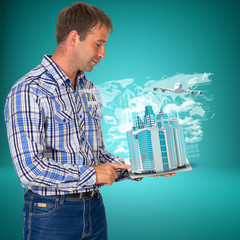Man hold tablet pc with airplane, skyscrapers and arrow