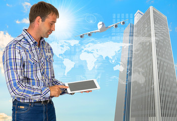 Man hold tablet pc. Airplane, skyscrapers and world map