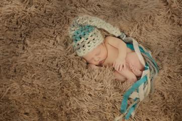 Baby mit Zipfelmütze
