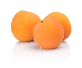 Three whole apricots isolated on white