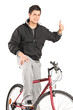 Young man on a bike giving a thumb up