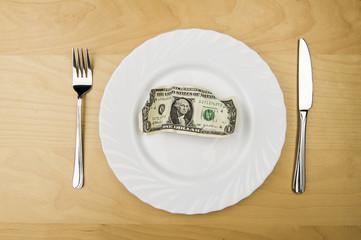 US Dollar Schein  auf einem Teller