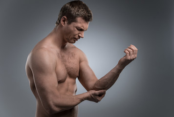 young man having pain in his elbow.