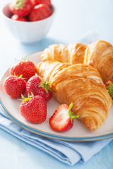fresh croissants with jam and strawberry for breakfast
