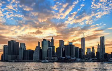 New York Skyline with powerful cloudy sunset