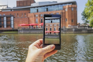 tourist taking picture on mobile phone