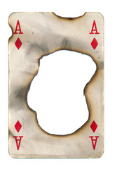 burn hole in old playing card ace of diamonds paper background