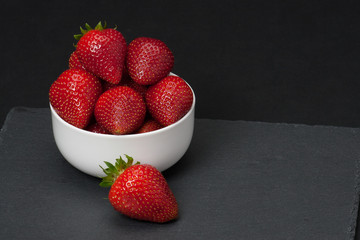 Fresh Strawberries In A Bowl. Natural Slate Placemat