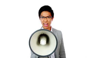 Portrait of angry asian man shouting with megaphone