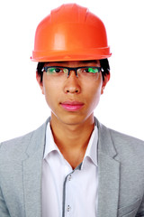 Portrait of a handsome asian man in helmet over white background