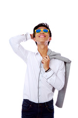 Asian man in sunglasses looking up over white background